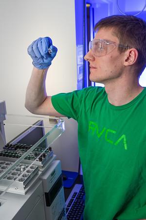 Chemistry major James Micah Simmerman completes a procedure in a Reichardt Building lab.  Filename: AAR-12-3598-139.jpg