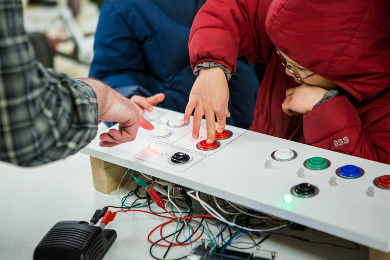 """Children are given a chance to explore during the annual Eweek open house in the Duckering Building on campus.  <div class=""""ss-paypal-button"""">Filename: AAR-14-4081-98.jpg</div><div class=""""ss-paypal-button-end""""></div>"""