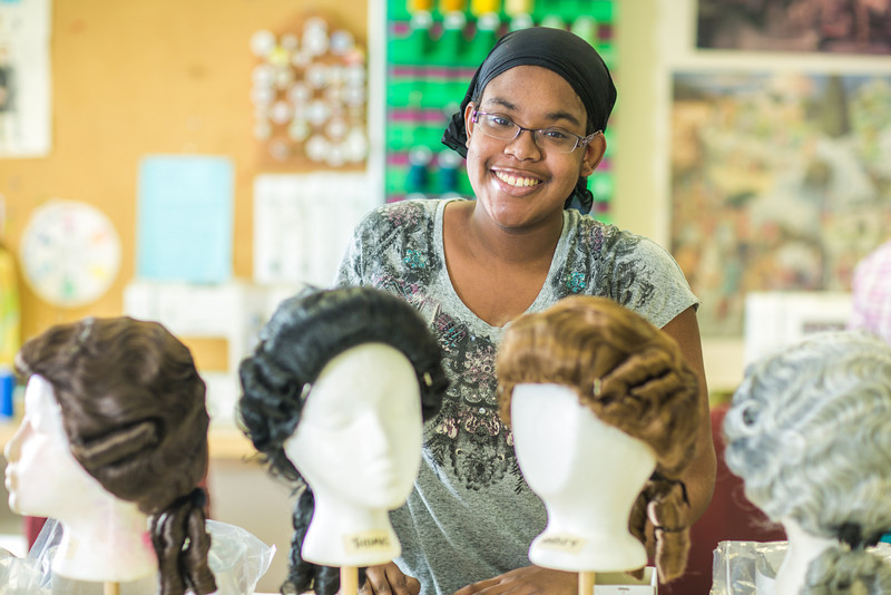 "Sophomore theater major Erlee Hjellen works at ""wig master"" for Theatre UAF's production of Tartuffe.  <div class=""ss-paypal-button"">Filename: AAR-14-4104-167.jpg</div><div class=""ss-paypal-button-end"" style=""""></div>"