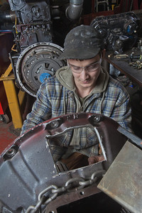 George Jensen disassembles a transmission in the diesel mechanics lab at the Hutchison Institute of Technology.  Filename: AAR-12-3312-047.jpg