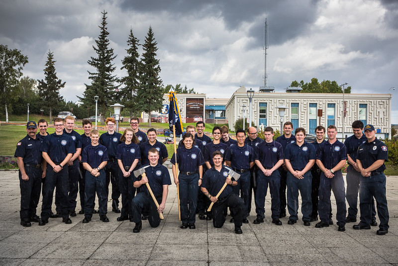 """The 2016 Summer Fire Academy graduates gather for a portrait under the rain after the commencement ceremony on the Fairbanks campus.  <div class=""""ss-paypal-button"""">Filename: AAR-16-4960-238.jpg</div><div class=""""ss-paypal-button-end""""></div>"""