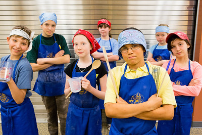 Students from Summer Sessions' Café Tween pose for a photograph after cooking Italian cuisine at Hutchinson's kitchen.  Filename: AAR-12-3432-43.jpg
