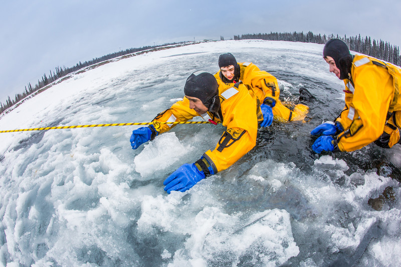 """Student firefighters practice cold-water rescue techniques at a pond near the Fairbanks campus.  <div class=""""ss-paypal-button"""">Filename: AAR-13-3797-29.jpg</div><div class=""""ss-paypal-button-end"""" style=""""""""></div>"""