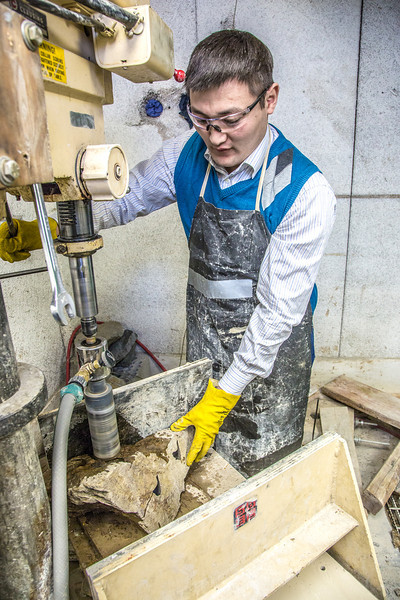 """UAF graduate student Erdenebaatar Dondov works with samples of rare earth minerals in a Duckering Building lab. Narantsetseg is part of a partnership between UAF and the Mongolian government to establish a school of mining engineering there to educate locals to help develop the country's mineral resources.  <div class=""""ss-paypal-button"""">Filename: AAR-13-3842-126.jpg</div><div class=""""ss-paypal-button-end"""" style=""""""""></div>"""