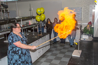 UAF chemistry professor Cathy Cahill seems to enjoy blowing up balloons filled with hydrogen during a demonstration for her students in a Reichardt Building lab.  Filename: AAR-13-4021-2.jpg