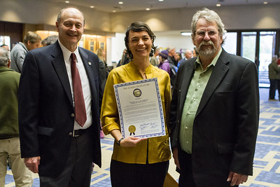 Members of the Alaska legislature Rep. David Guttenberg and Sen. Joe Thomas present UAF Film department head Maya Salganek with a copy of the proclamation. The state voted to continue to offer economic incentives for film and television producers to shoot in Alaska. Salganek was vital in organizing a grassroots campaign that demonstrated strong support for the program.  Filename: AAR-12-3558-49.jpg