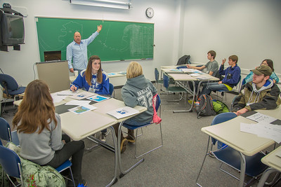 Faculty member Dave Veazey leads a mock geography class during an Inside Out event in a Gruening Building classroom.  Filename: AAR-12-3609-47.jpg