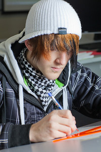 Jacob Carter works through his weekly drafting assignment at UAF's Community and Technical College.  Filename: AAR-11-3221-79.jpg