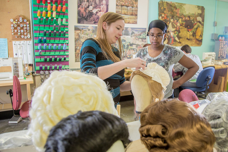 """Assistant professor Bethany Marx (left) works with her student """"wig master"""" Erlee Hjellen in the costume shop during preparations for Theatre UAF's spring 2014 production of """"Tartuffe.""""  <div class=""""ss-paypal-button"""">Filename: AAR-14-4104-227.jpg</div><div class=""""ss-paypal-button-end"""" style=""""""""></div>"""