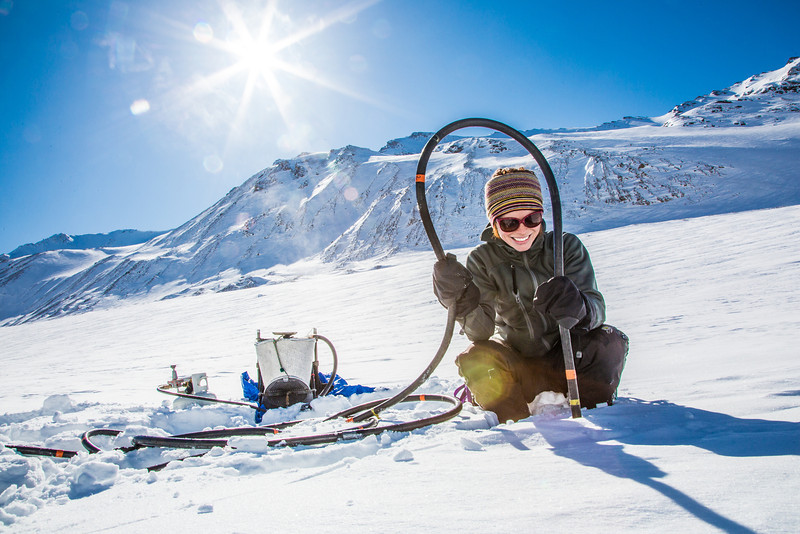 """Geophysical Institute graduate student Joanna  Young sets up a steam drill to install stakes for measuring glacier melt on the Jarvis Glacier, about 35 miles south of Delta Junction.  <div class=""""ss-paypal-button"""">Filename: AAR-13-3795-639.jpg</div><div class=""""ss-paypal-button-end"""" style=""""""""></div>"""