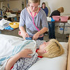 """Sarah Mergen practices taking the blood pressure of fellow student Mollie Egger during an exercise in their nurse aide training program at UAF's Community and Technical College.  <div class=""""ss-paypal-button"""">Filename: AAR-12-3548-052.jpg</div><div class=""""ss-paypal-button-end"""" style=""""""""></div>"""