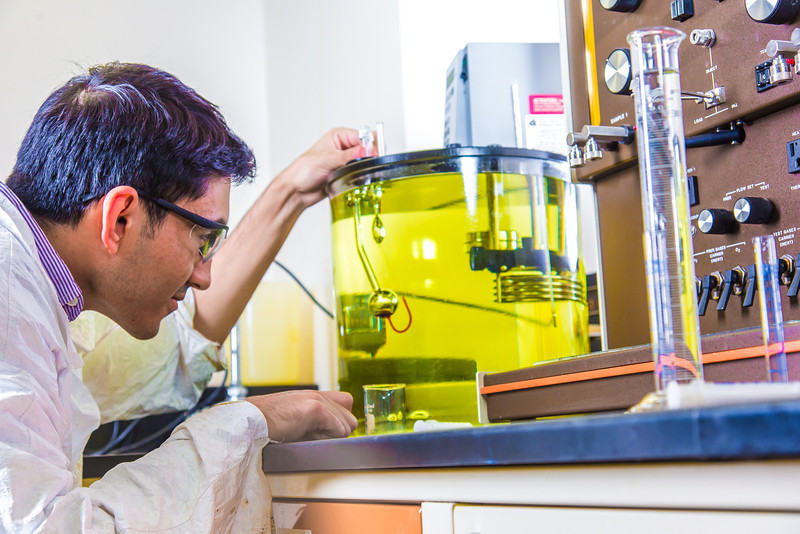 "Graduate student Behnam Zanganeh sets up apparatus for a procedure in UAF's Petroleum Development Lab in the Duckering Building.  <div class=""ss-paypal-button"">Filename: AAR-13-3918-203.jpg</div><div class=""ss-paypal-button-end"" style=""""></div>"