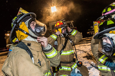 UFD student firefighters don their gear before tackling a live blaze during a drill at the Fairbanks International Airport.  Filename: AAR-13-3995-56.jpg