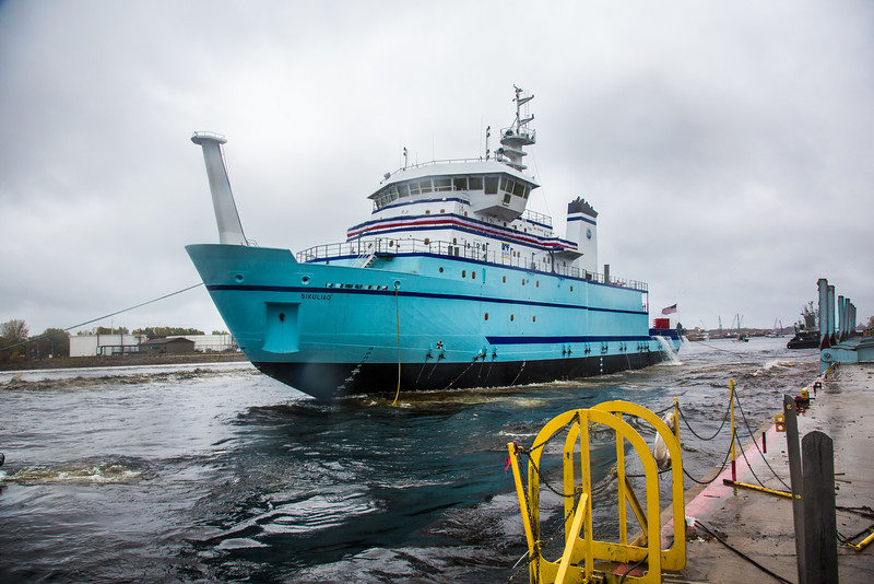 """The R/V Sikuliaq comes to rest in the Menominee River seconds after its launch at the Marinette Marine Corp. in Marinette, Wisc.  <div class=""""ss-paypal-button"""">Filename: AAR-12-3594-143.jpg</div><div class=""""ss-paypal-button-end"""" style=""""""""></div>"""