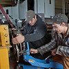 "Tony Craig, left, and George Jensen work together disassembling a transmission in the diesel mechanics lab at the Hutchison Institute of Technology.  <div class=""ss-paypal-button"">Filename: AAR-12-3312-092.jpg</div><div class=""ss-paypal-button-end"" style=""""></div>"