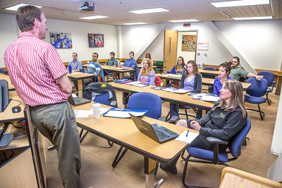 Brent Sheets, left, research manager for the Alaska Center for Energy and Power, addresses a  group of new ACEP interns in a Duckering Building classroom.  Filename: AAR-13-3840-5.jpg