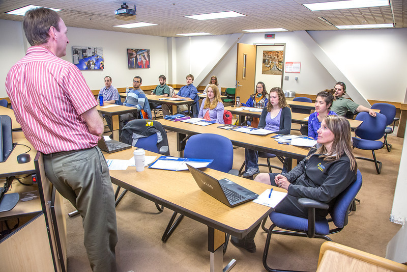 """Brent Sheets, left, research manager for the Alaska Center for Energy and Power, addresses a  group of new ACEP interns in a Duckering Building classroom.  <div class=""""ss-paypal-button"""">Filename: AAR-13-3840-5.jpg</div><div class=""""ss-paypal-button-end"""" style=""""""""></div>"""