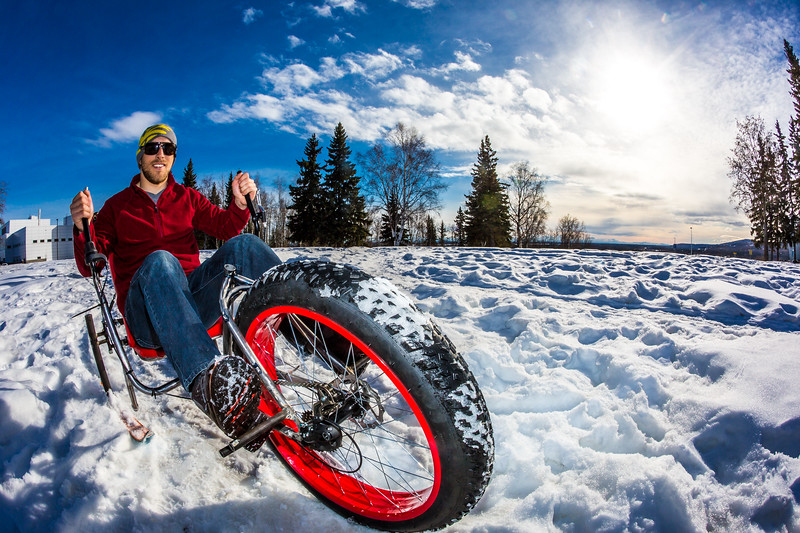 """Mechanical engineering major Neil Gotschall demonstrates the fat tire ski bike he and two partners designed and built for paraplegic users as their spring 2016 senior design project. The bike is powered by pushing and pulling on the handles.  <div class=""""ss-paypal-button"""">Filename: AAR-16-4856-30.jpg</div><div class=""""ss-paypal-button-end""""></div>"""