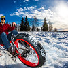 "Mechanical engineering major Neil Gotschall demonstrates the fat tire ski bike he and two partners designed and built for paraplegic users as their spring 2016 senior design project. The bike is powered by pushing and pulling on the handles.  <div class=""ss-paypal-button"">Filename: AAR-16-4856-30.jpg</div><div class=""ss-paypal-button-end""></div>"