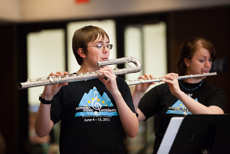 """Ray Hogenson plays the bass flute with a flute choir during the Summer Music Academy's Celtic Music concert.  <div class=""""ss-paypal-button"""">Filename: AAR-12-3439-54.jpg</div><div class=""""ss-paypal-button-end"""" style=""""""""></div>"""