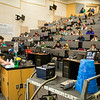 "Children and their parents receive a physics lecture from David Newman during Science Potpourriat the Reichardt Building.  <div class=""ss-paypal-button"">Filename: AAR-14-4141-87.jpg</div><div class=""ss-paypal-button-end""></div>"