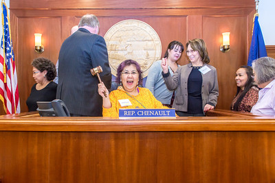 Molly Jacobson, a senior in UAF's rural development program from Bethel, has some fun with the gavel moments after posing with House Speaker Mike Chenault during a weeklong seminar on understanding the legislative process in Juneau.  Filename: AAR-14-4053-146.jpg