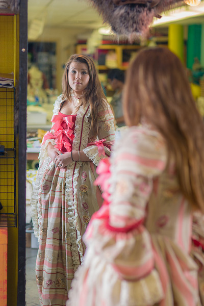"""Theater major Katrina Kuharich checks out her dress for the Theatre UAF production of Tartuffe during a fitting in the department's costume shop  <div class=""""ss-paypal-button"""">Filename: AAR-14-4104-117.jpg</div><div class=""""ss-paypal-button-end"""" style=""""""""></div>"""