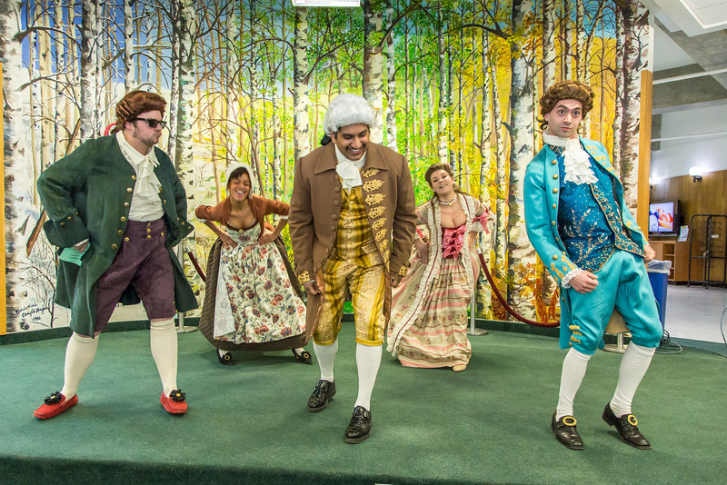 """Cast members of Theatre UAF's production of """"Tartuffe"""" perform an original dance as part of a live teaser in Wood Center a couple of days before opening night.  <div class=""""ss-paypal-button"""">Filename: AAR-14-4121-51.jpg</div><div class=""""ss-paypal-button-end"""" style=""""""""></div>"""