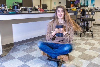 Physics major Haley Nelson takes a spin after class in a Reichardt Building lab.  Filename: AAR-13-4009-185.jpg