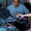 "Program lab assistant Joel Sturm applies hair spray before junior science major Arch Chauhan starts printing during an open work session in UAF's Community and Technical College's 3-D print lab in downtown Fairbanks.  <div class=""ss-paypal-button"">Filename: AAR-16-4857-046.jpg</div><div class=""ss-paypal-button-end""></div>"