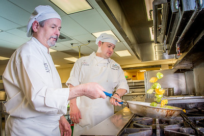 Chris Redmond, left, and Joshua Broda prepare squash to serve during lunch at CTC's culinary arts kitchen in the Hutchison Center.  Filename: AAR-13-3811-63.jpg