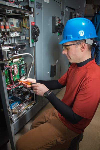 """Jay Ranson wires a large circuit box at CTC's process technology facility on Van Horn Road.  <div class=""""ss-paypal-button"""">Filename: AAR-11-3230-125.jpg</div><div class=""""ss-paypal-button-end"""" style=""""""""></div>"""