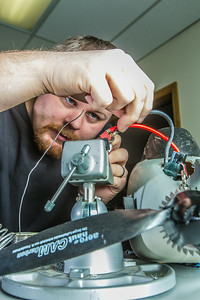 Technician Michael Cook works on one of the unmanned aerial vehicles in UAF's Alaska Center for Unmanned Aircraft Systems Integration (ACUASI) shop in south Fairbanks.  Filename: AAR-13-4026-56.jpg