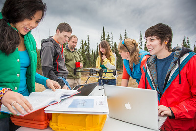 Students take part in a project using unmaned aerial vehicles (UAVs) at Poker Flat Research Range about 40 miles northeast of the Fairbanks campus. (Note: Taken as part of commercial shoot with Nerland Agency. Pretend class -- use with discretion!)  Filename: AAR-12-3560-013.jpg