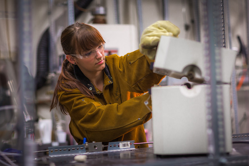 """Ph.D. candidate Amanda Lindoo works in the Reichardt Building petrology lab.  <div class=""""ss-paypal-button"""">Filename: AAR-16-4828-130.jpg</div><div class=""""ss-paypal-button-end""""></div>"""