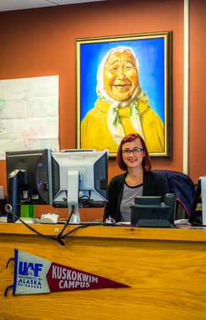 Administrative assistant Heidi Geerdts greets visitors to UAF's Kuskokwim Campus in Bethel.  Filename: AAR-16-4859-108.jpg
