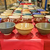 "Ceramic bowls made by UAF art major Ian Wilkinson are laid out on tables at the Fairbanks Community Food Bank to be sold as part of his senior thesis project. All 1,200 individual bowls sold in about 30 minutes, raising about $18,000 donated to the local charity.  <div class=""ss-paypal-button"">Filename: AAR-13-3790-5.jpg</div><div class=""ss-paypal-button-end"" style=""""></div>"