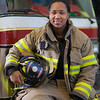 "UAF student firefighter/EMTs Lillian Hampton poses by one of the firetrucks housed in the Whitaker Building on the Fairbanks campus.  <div class=""ss-paypal-button"">Filename: AAR-11-3223-151.jpg</div><div class=""ss-paypal-button-end"" style=""""></div>"