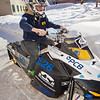 "Engineering major Isaac Thompson drives the electric snowmachine he and other members of his team helped modify into the Duckering Building after its return to campus after claiming the top prize in the SAE Clean Showmobile Challenge in Houghton, Mich.  <div class=""ss-paypal-button"">Filename: AAR-12-3337-52.jpg</div><div class=""ss-paypal-button-end"" style=""""></div>"