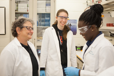 Grad student Laura Teigen in Kristin O'Brien's lab pauses for a break with Paula Dell and Ololade Olawale.  Filename: AAR-12-3457-2.jpg