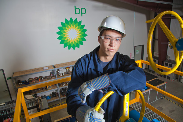 """Stefan Weingarth opens a valve on the oil field well head at CTC's process technology facility on Van Horn Road.  <div class=""""ss-paypal-button"""">Filename: AAR-11-3230-058.jpg</div><div class=""""ss-paypal-button-end"""" style=""""""""></div>"""