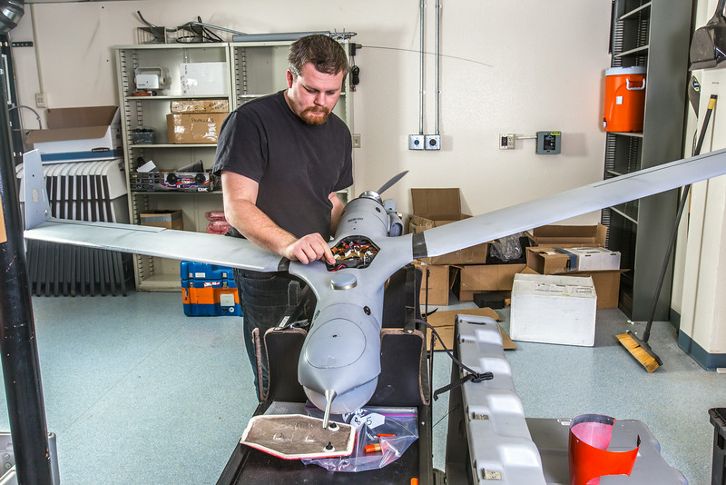 """Technician Michael Cook works on one of the unmanned aerial vehicles in UAF's Alaska Center for Unmanned Aircraft Systems Integration (ACUASI) shop in south Fairbanks.  <div class=""""ss-paypal-button"""">Filename: AAR-13-4026-165.jpg</div><div class=""""ss-paypal-button-end""""></div>"""