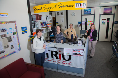 Staff members Ginny Redmond, left, Vernae Angnaboogok, Jen Bergstrom and Sarah Smith greet students at the front counter of UAF's Student Support Services.  Filename: AAR-12-3285-189.jpg