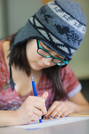 Michelle Kubo works through her assignment in her drafting class at UAF's Community and Technical College.  Filename: AAR-11-3221-08.jpg