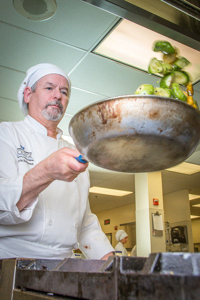 "Chris Redmond prepares squash to serve during lunch at CTC's culinary arts kitchen in the Hutchison Center.  <div class=""ss-paypal-button"">Filename: AAR-13-3811-76.jpg</div><div class=""ss-paypal-button-end"" style=""""></div>"