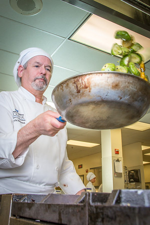 Chris Redmond prepares squash to serve during lunch at CTC's culinary arts kitchen in the Hutchison Center.  Filename: AAR-13-3811-76.jpg