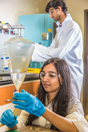 Graduate student Shruti Oza sets up apparatus for a procedure in UAF's Petroleum Development Lab in the Duckering Building.  Filename: AAR-13-3918-221.jpg