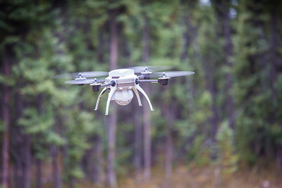 Students take part in a project using unmaned aerial vehicles (UAVs) at Poker Flat Research Range about 40 miles northeast of the Fairbanks campus. (Note: Taken as part of commercial shoot with Nerland Agency. Pretend class -- use with discretion!)  Filename: AAR-12-3560-120.jpg