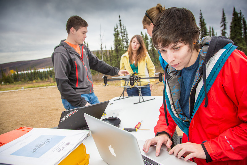 """Students take part in a project using unmaned aerial vehicles (UAVs) at Poker Flat Research Range about 40 miles northeast of the Fairbanks campus. (Note: Taken as part of commercial shoot with Nerland Agency. Pretend class -- use with discretion!)  <div class=""""ss-paypal-button"""">Filename: AAR-12-3560-005.jpg</div><div class=""""ss-paypal-button-end"""" style=""""""""></div>"""