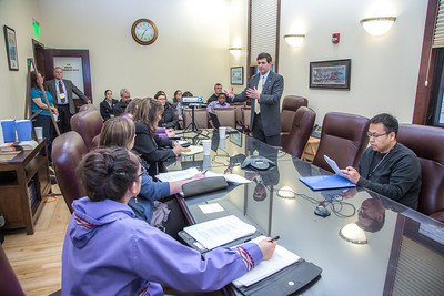 Professor Mike Davis and his students in RD 492 - Understanding the Legislative Process, meet with Sen. Bill Wielechowski, (D, Anchorage) in a legislative conference room during their week-long seminar in Juneau.  Filename: AAR-13-3714-474.jpg